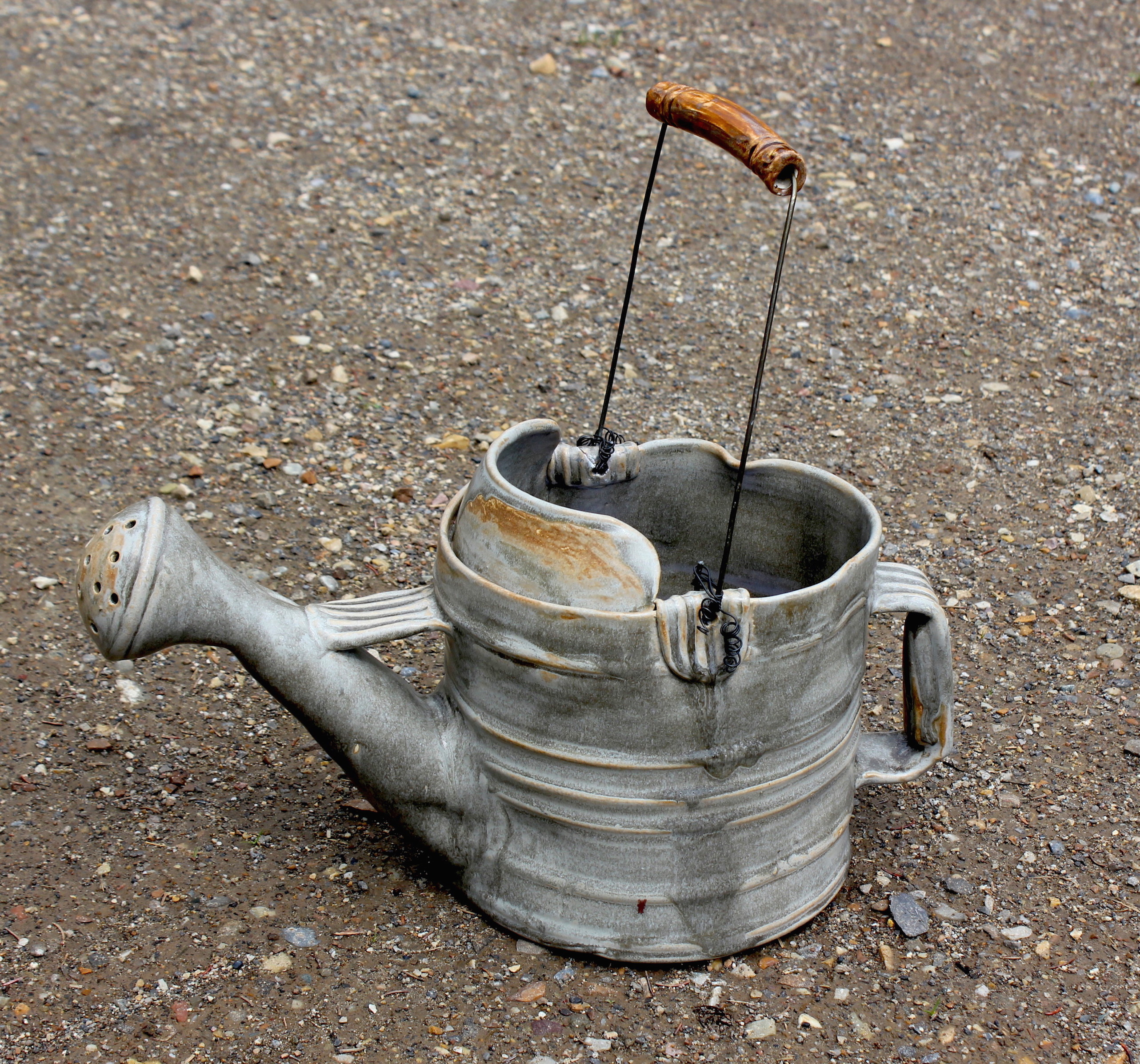 """The Ol' Watering Can"""